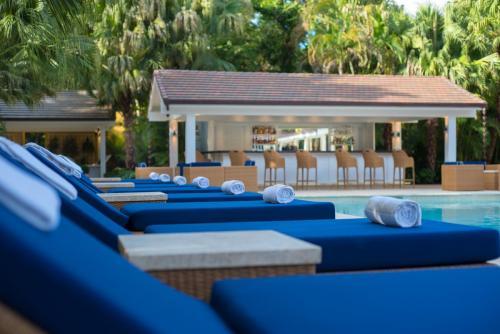 Tortuga Bay Chaise Lounge Pool Area  Bamboo Bar